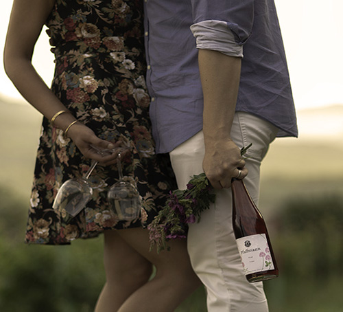 Lovers with fresh flowers and Organic WIne
